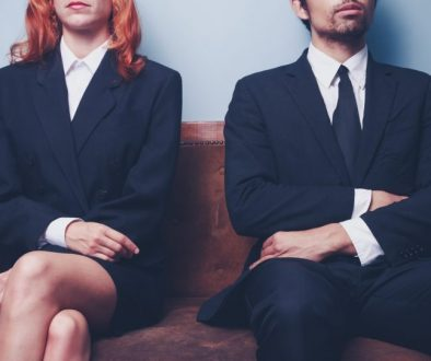 Man and woman waiting on a sofa